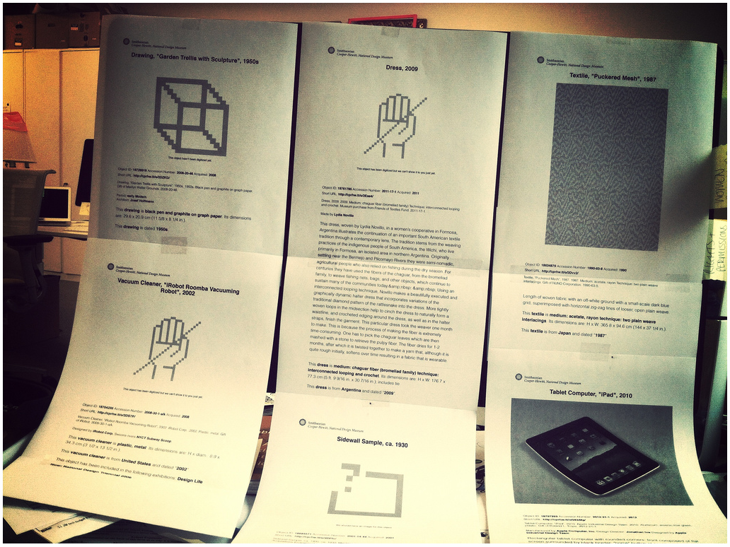 six printouts on standard paper from the collections website, taped in two rows to an iMac screen.